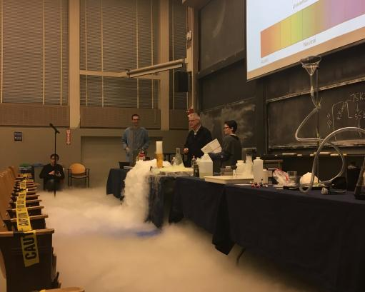 Students conduct a magic show experiment using dry ice.