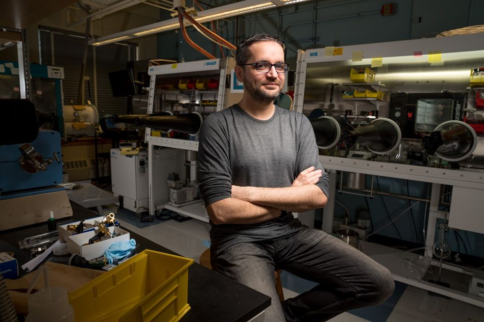 Mircea Dinca sits in his lab