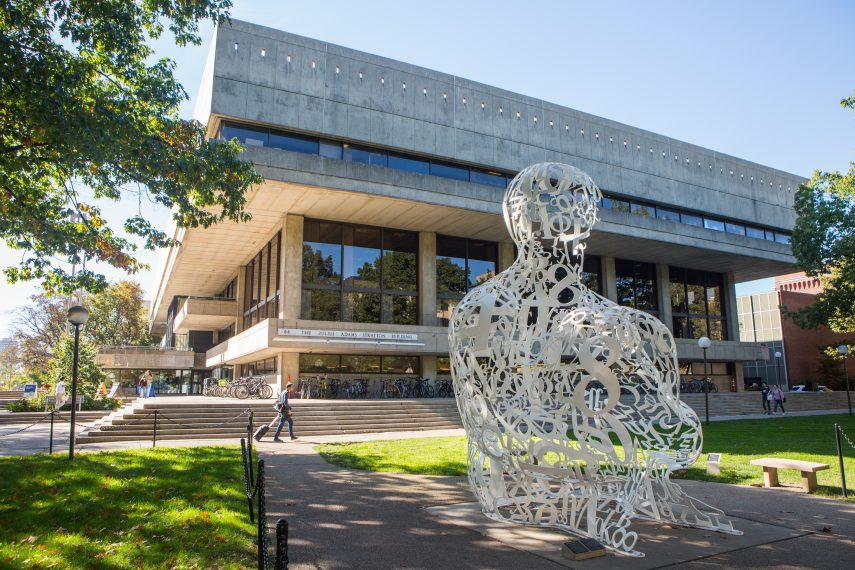 Sculpture of a man in on MIT Campus