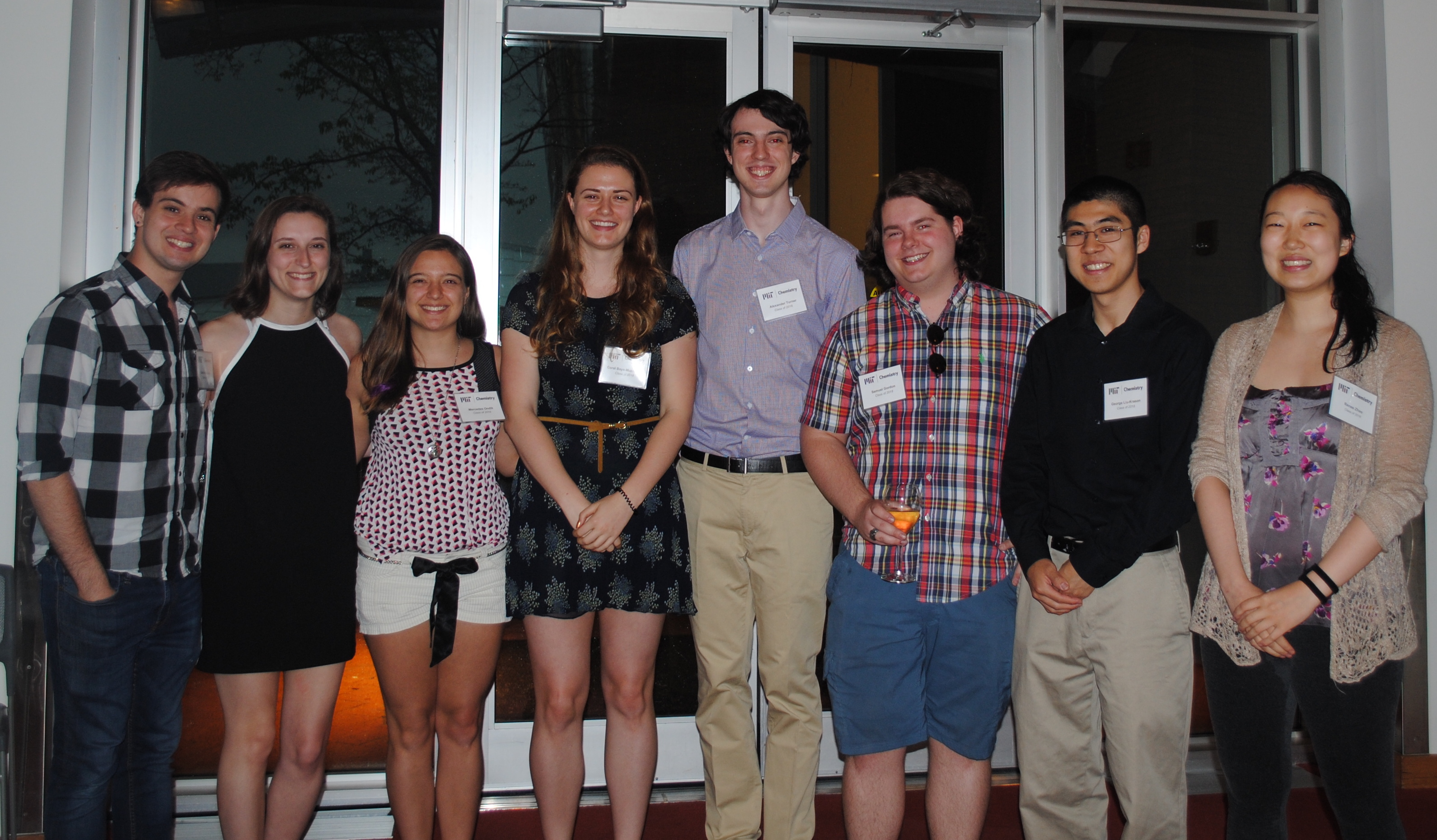 Undergraduate Majors stand for a group photo at a banquet.