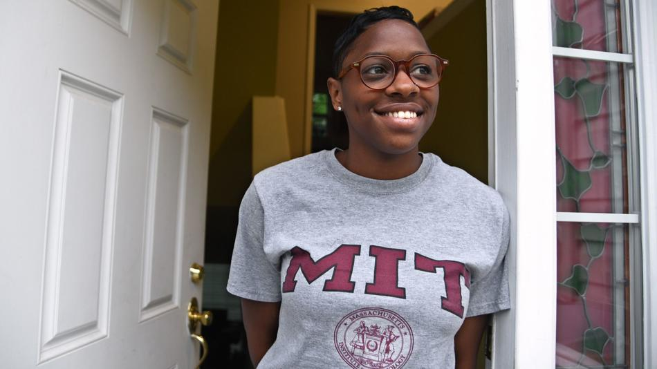 Graduate Student Corshai Williams smiles wearing an MIT shirt.