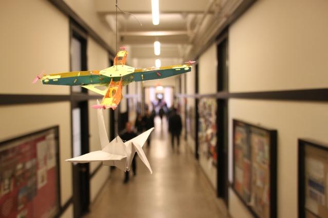 Paper cranes hover in the MIT infinite corridor.