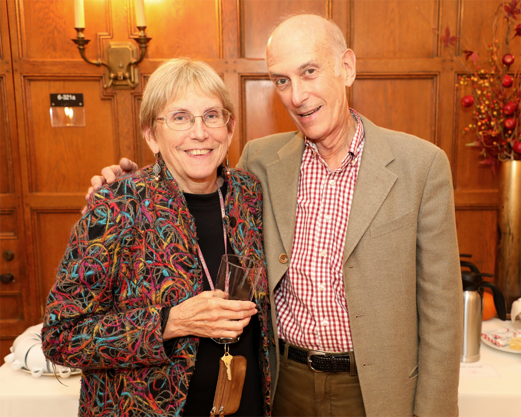 Professor JoAnne Stubbe and Professor Stephen J. Lippard smile side by side at their retirement party.