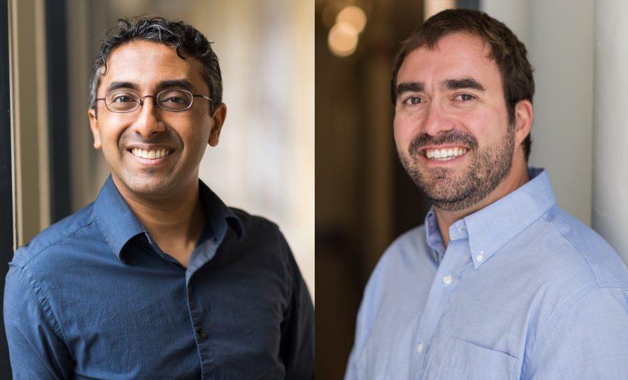 Professors Surendranath and Willard smile in a hallway.