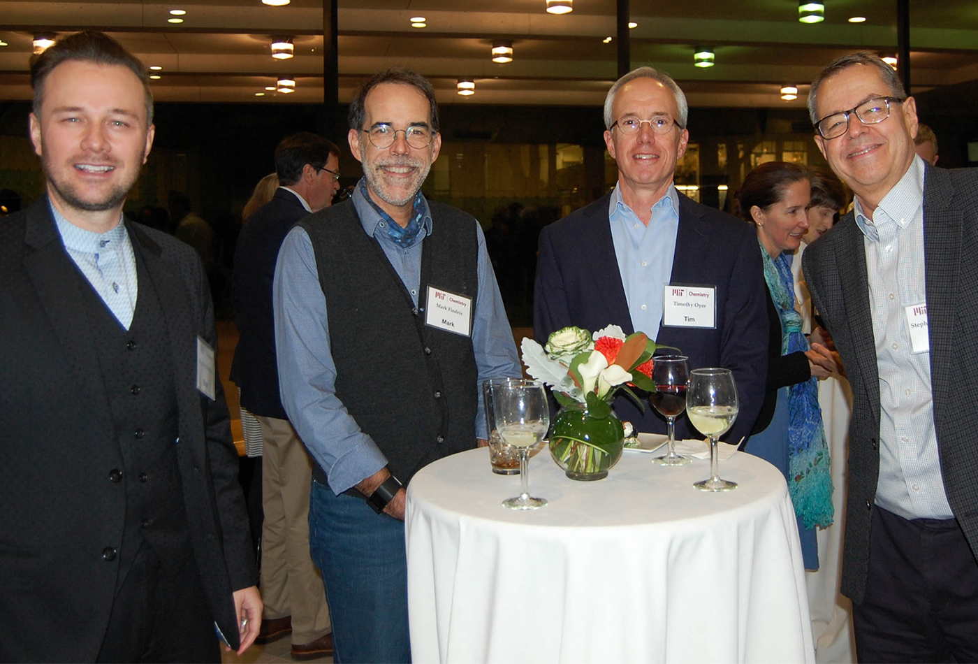 Dr. Mark Findeis, (SB 1981, V), Tim Oyer (PhD 1991, V), Prof. Steve Buchwald enjoying food and drinks..