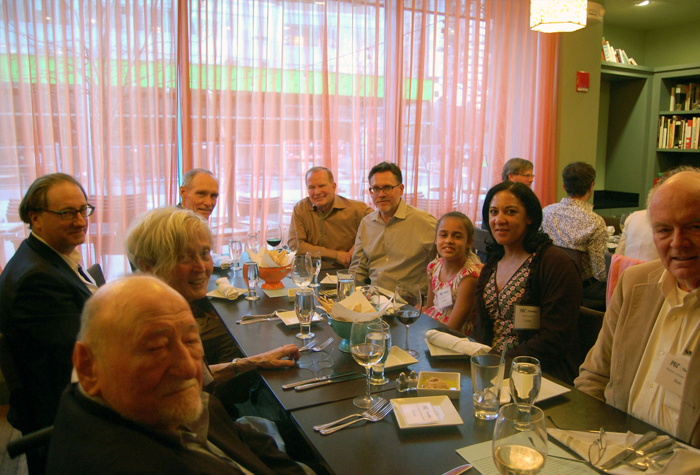 L-R: (clockwise) seated at dinner: Prof. Emeritus Dietmar Seyferth, Helena Seyferth, Howard Withers, PhD '81, James Kronauge, PhD '87 (Davison), Prof. Christopher Cummins, Cosette Cummins, Lisette Cummins, Robert Lambert, PhD '73