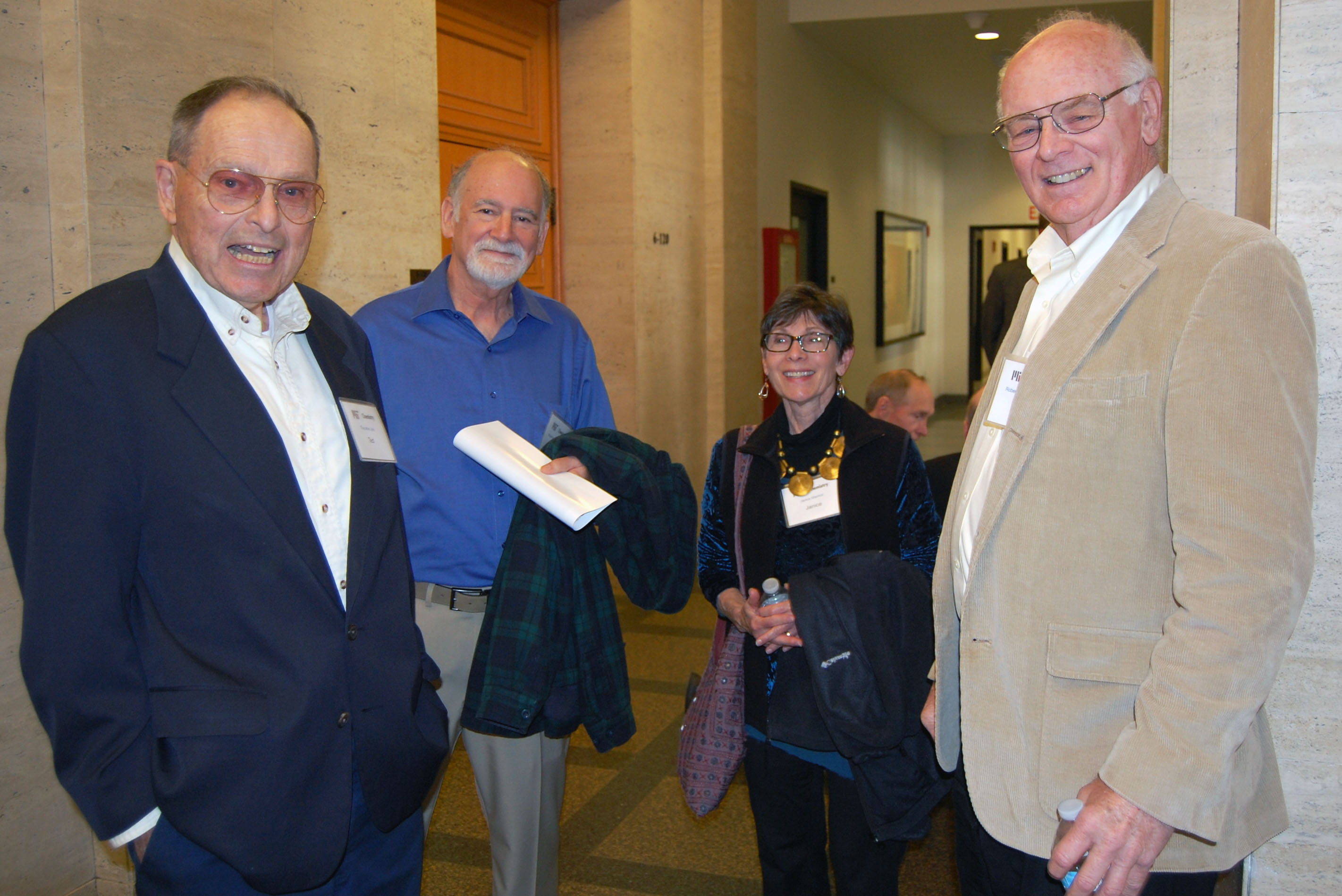 L-R: Theodore Jula, PhD '67 (Seyferth), Robert Marmor, PhD '70 (Seyferth), Janice Marmor, Robert Lambert, PhD '73 (Seyferth) pose outside Room 6-120