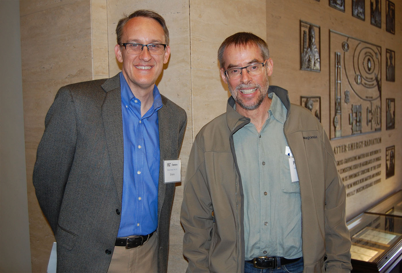 Former Seyferth graduate students: Shane Krska, PhD '97 and Henry Tracy, PhD '90 pose outside Room 6-120