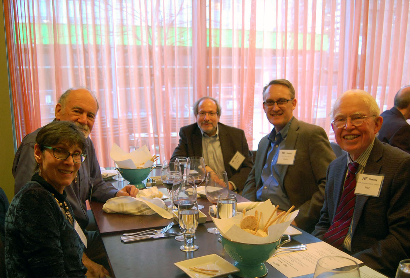 L-R (clockwise) seated at dinner: Janice Marmor, Robert Marmor, PhD'70, Prof. Rick Danheiser, Shane Krska, PhD'97, Prof. Emeritus Frederick Greene.