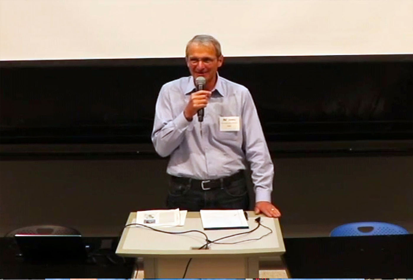 Frederick G. Keyes Professor Emeritus and 2005 Nobel Prize winner Richard R. Schrock,standing at the podium to give his opening remarks