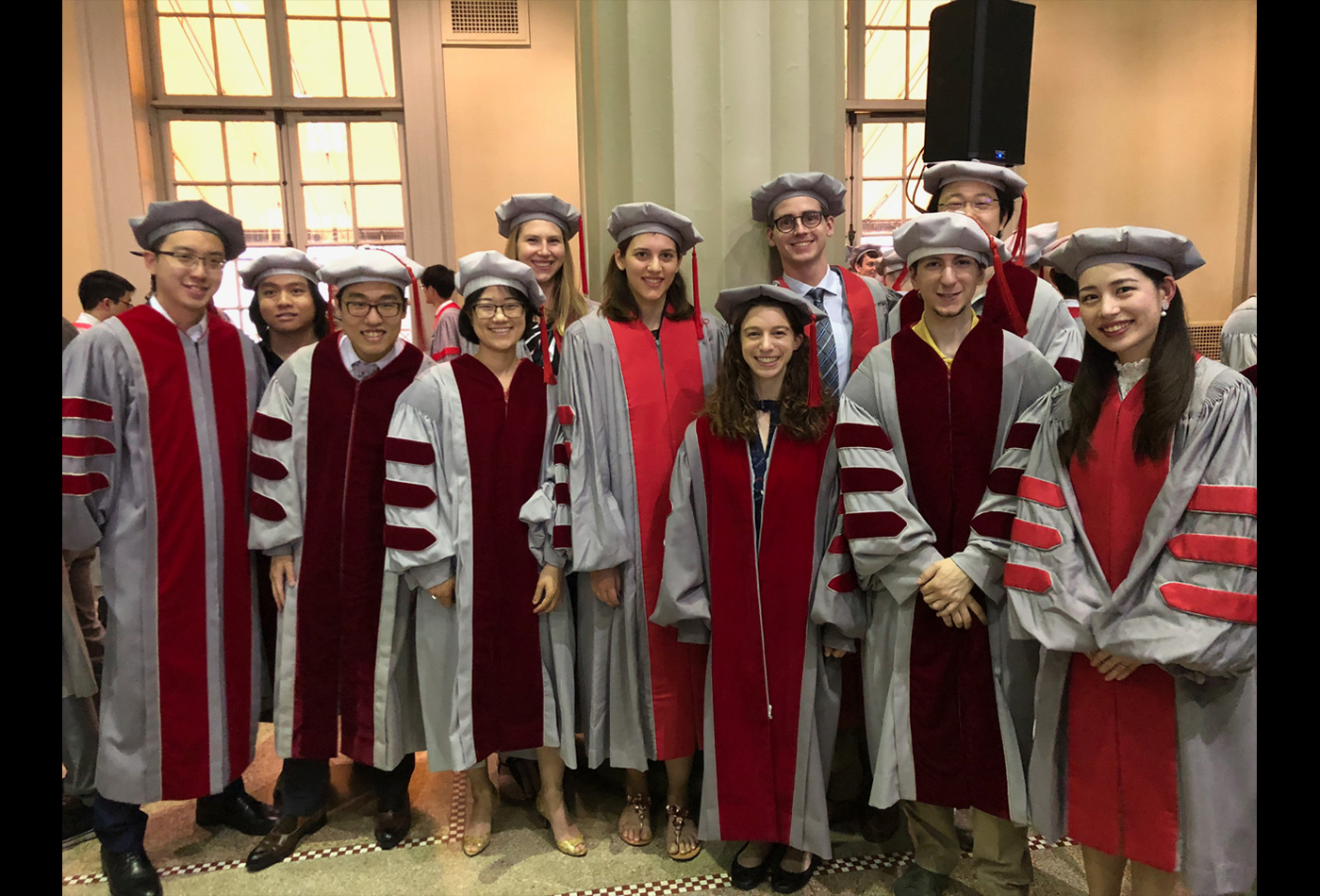 Doctoral students from the Department of Chemistry prepare to receive their hoods.