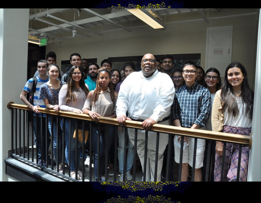 Dr. Booker is pictured center surrounded by students in the MIT Student Research Program