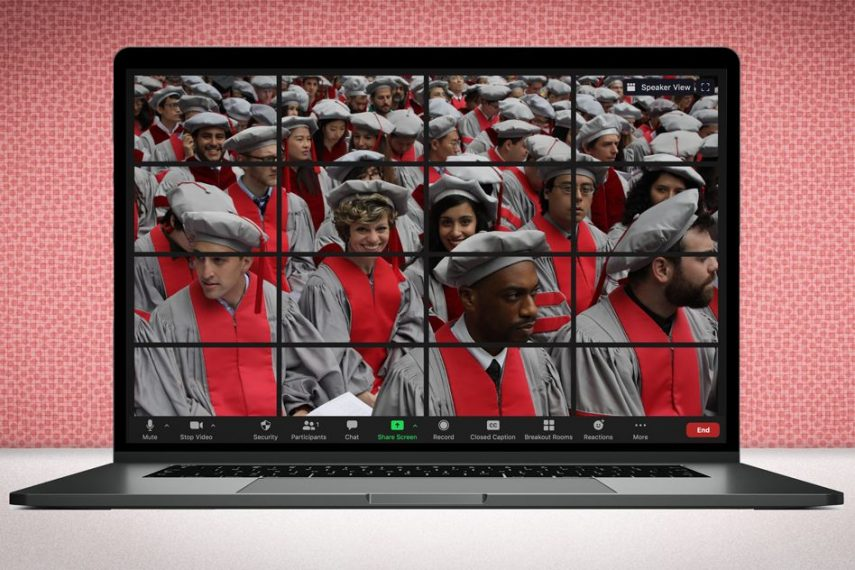 a laptop depicts a group of PhD graduates in regalia.