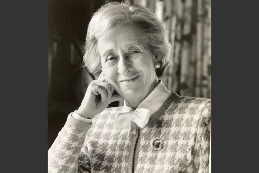 A black and white photo of an older woman.
