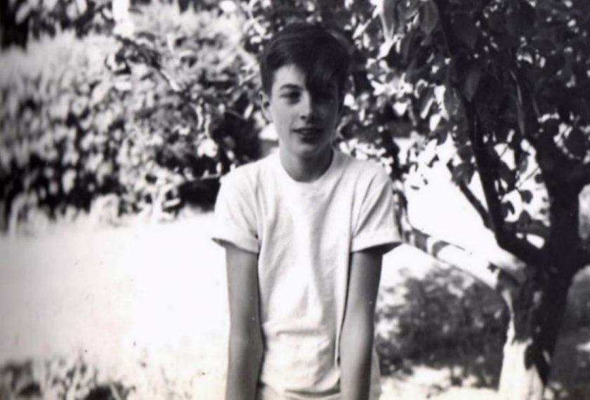 A black and white photo of a teenage boy.