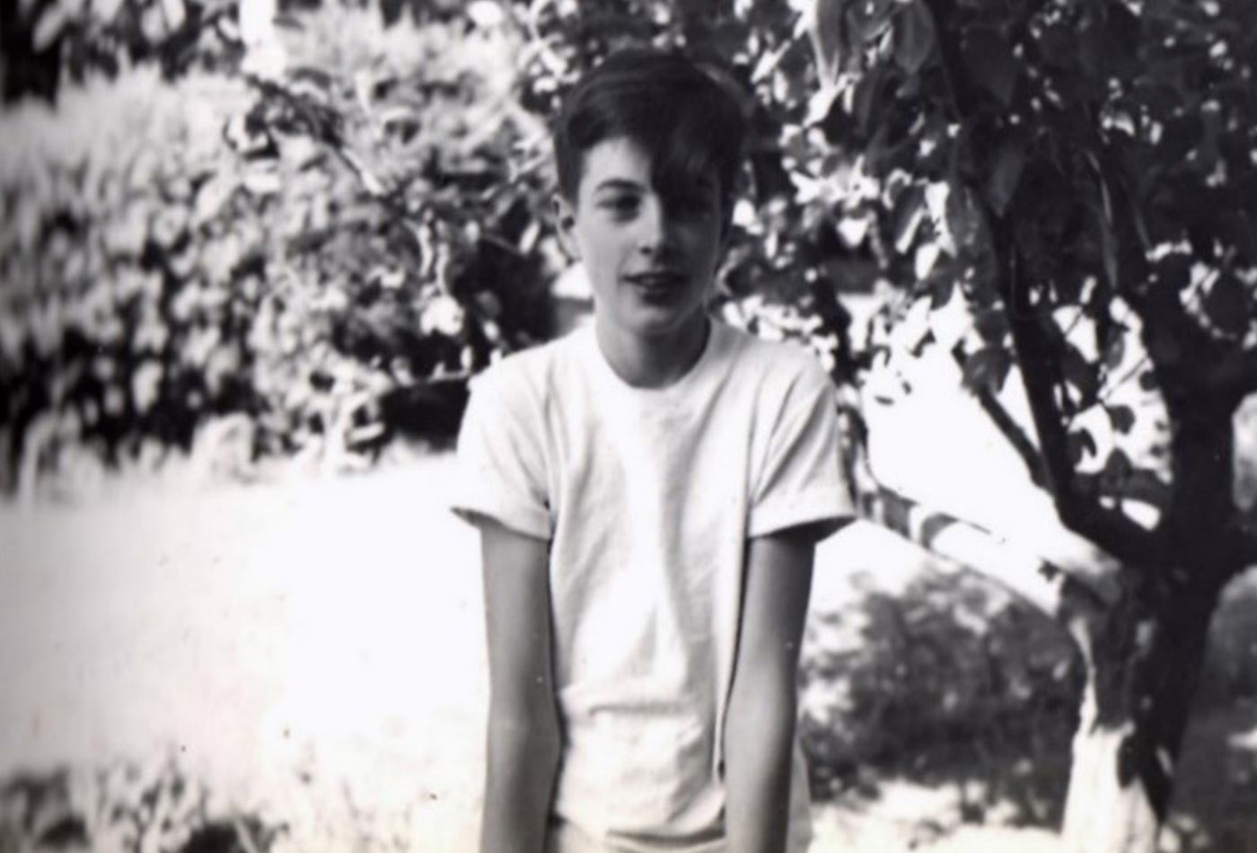 A black and white photo of a teenage boy.