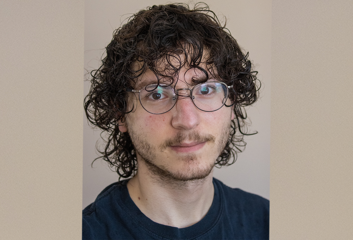 A headshot of a male graduate student wearing glasses.