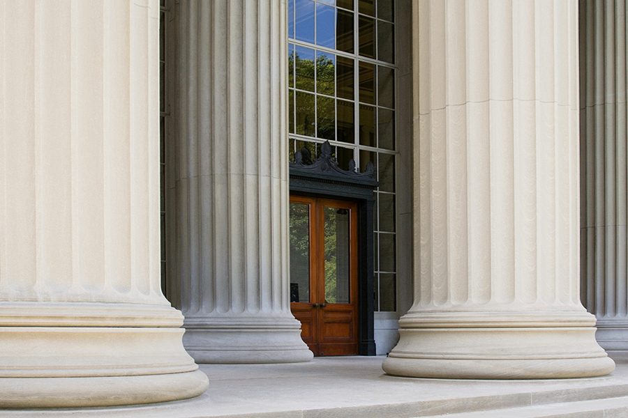 Cambridge, MA., USA - July 8, 2012: Killian Court and Great Dome Building 10 entrance doors on Massachusetts Institute of Technology campus.