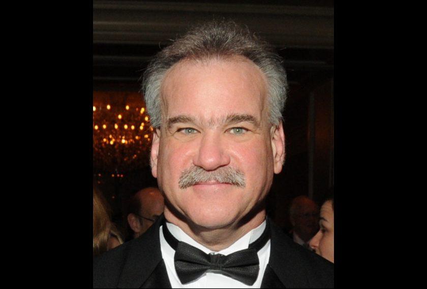 A photo of Scott Denmark in a tuxedo.