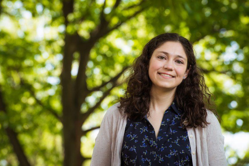A female graduate student outdoors.
